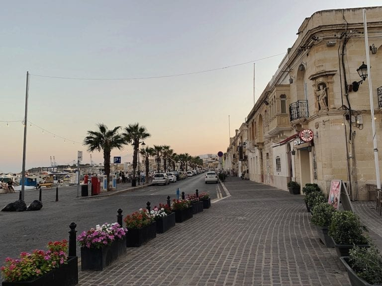 the peaceful fish town in malta near sunset hours