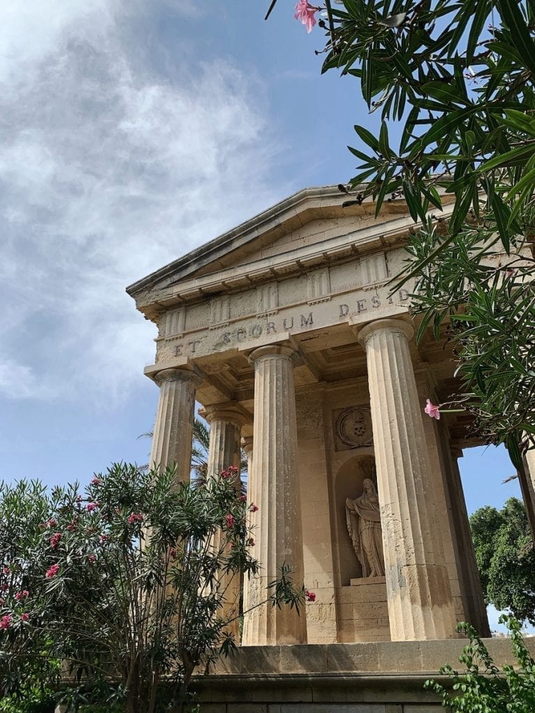 the lower barrakka garden has a temple with the ancient greek and romano tempo style