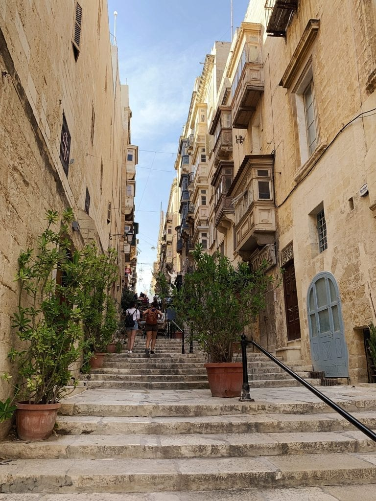 the stairs and the white color buildings are so classic in valletta old city center