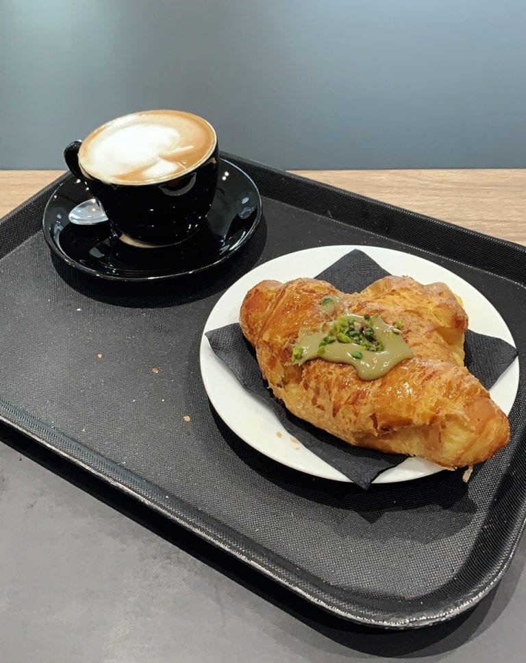 artisan croissant with yummy but not too sweet pistacchio cream inside and a cup of cappuccino is the normal breakfast in rome