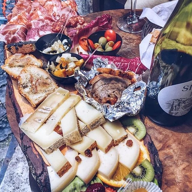 the beautiful platter with all italian's famous cold cuts and cheeses and it is great for a bottle of wine