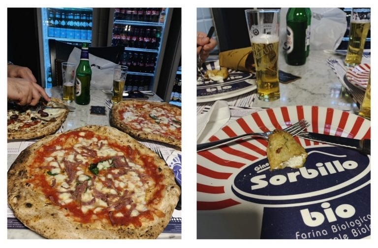 the pizza is bigger than the big plate in gino sorbillo pizza shop in rome