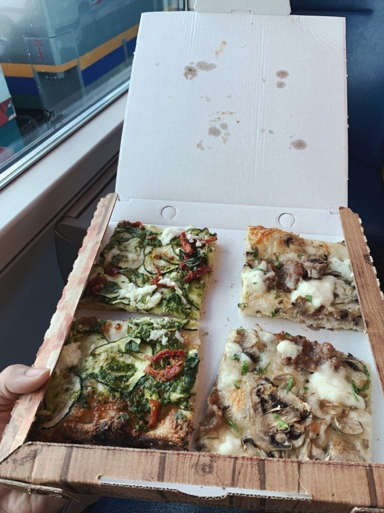 sliced pizza with many different flavors and fresh made from the oven is the best for a quick lunch or solo travelers
