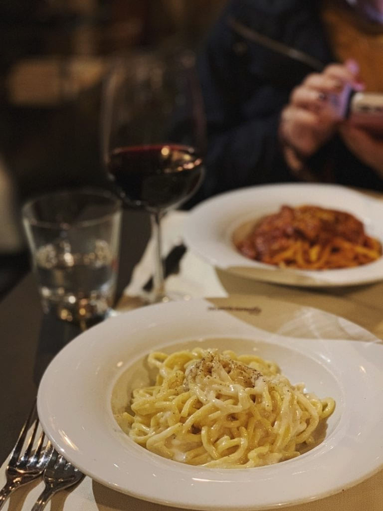 the yummy carbonara and amatricciana pasta from matriccianella restaurant in rome city center