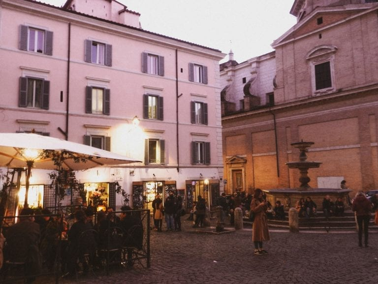 the purple sunset in the busiest square of cavour and the night life starts from there