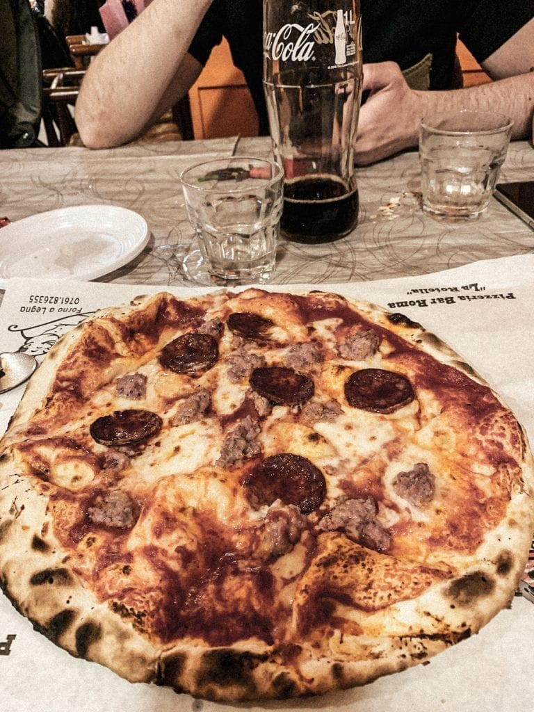 pizzeria la rotella of montefiascone serves their big pizza on the paper directly