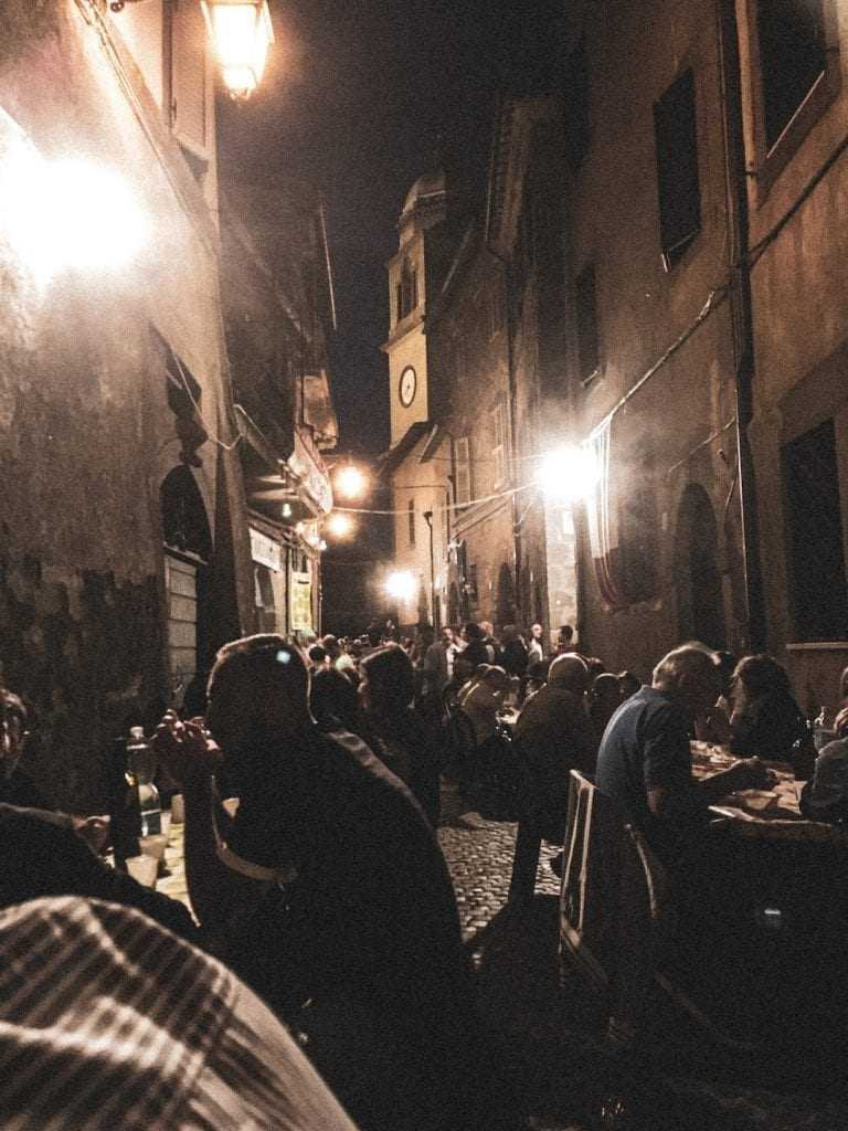 special summer wine festival and the local tradition of eating on the long benches on the street of old stone city in summer