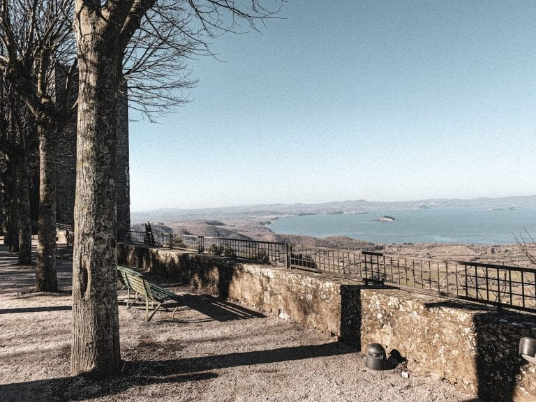 view of bolsena lake from the park under rocca dei papi in montefiascone