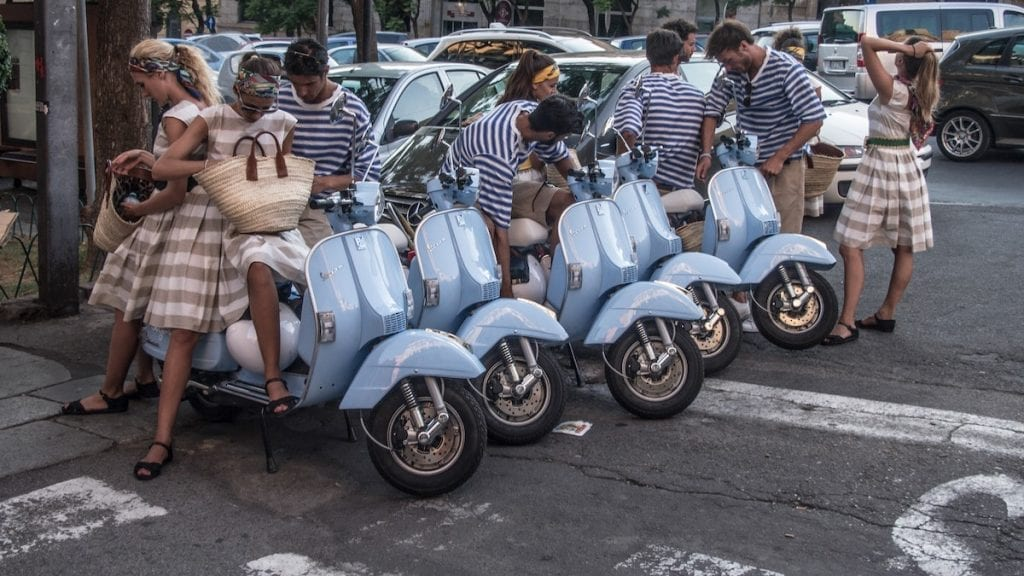 the beautiful italian girls and boys getting ready on a vespa ride