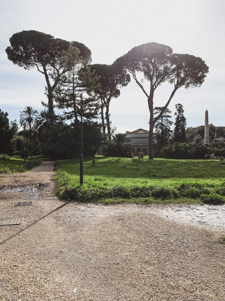 the large villa torlonia in the summer is the best place for people to walk around and enjoy the outdoor vibe