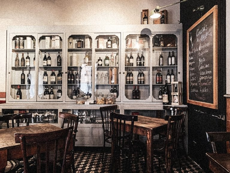 the cozy and casual bistro civico 4 in cavour with a wall of fine wines