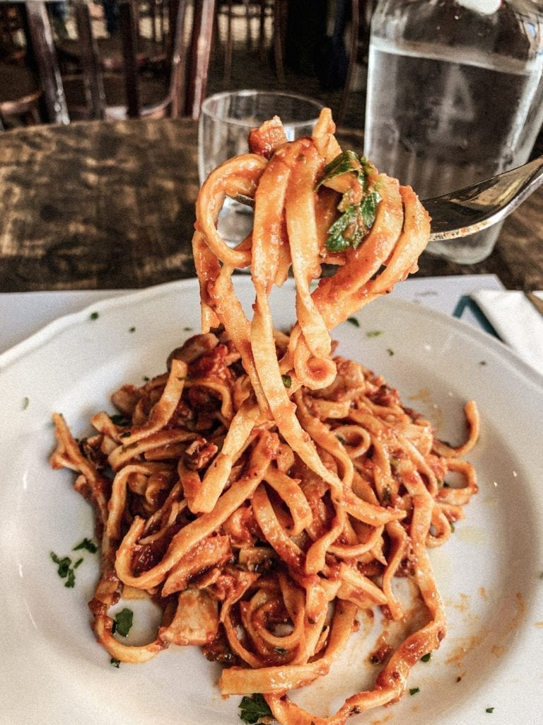 the yummy and simple tagliolini pasta with seafood and tomato sauce by civico 4 in cavour