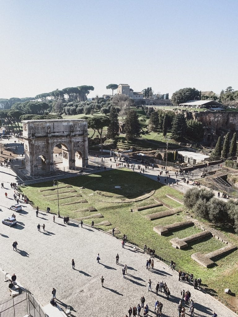a great view of palatine hill and arc of constantine from the 3rd level of colosseum