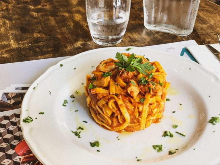 tagliatelle with ragu of octopus and tomato sauce by civico 4 in cavour neighborhood in rome is the best simple seafood pasta dish