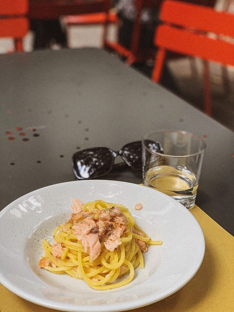 spaghetti pasta cooked with salmon and butter is a typical milan style or northern italian style pasta dish
