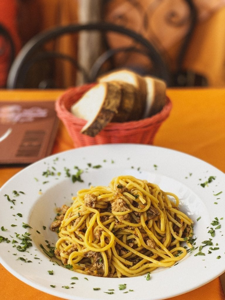 tonnarelli pasta with ragu of minced rabbit meat and porcini mushroom is an earthy but simple pasta dish by gli angeletti restaurant in cavour neighborhood in rome