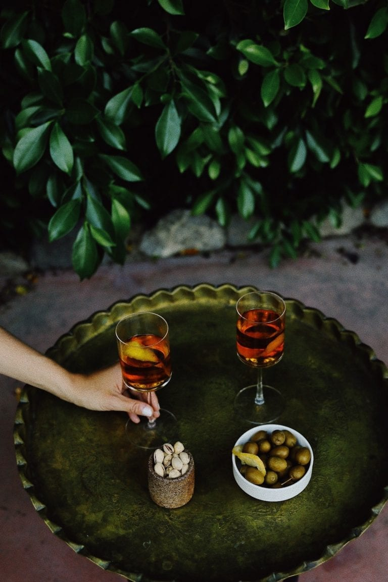 typical italian aperitivo is always going with a glass of classic italian cocktail like negroni or spritz