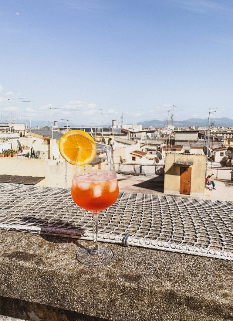 have a big glass of homemade aperol spritz on the rooftop when it is a lovely sunny weekend during lockdown