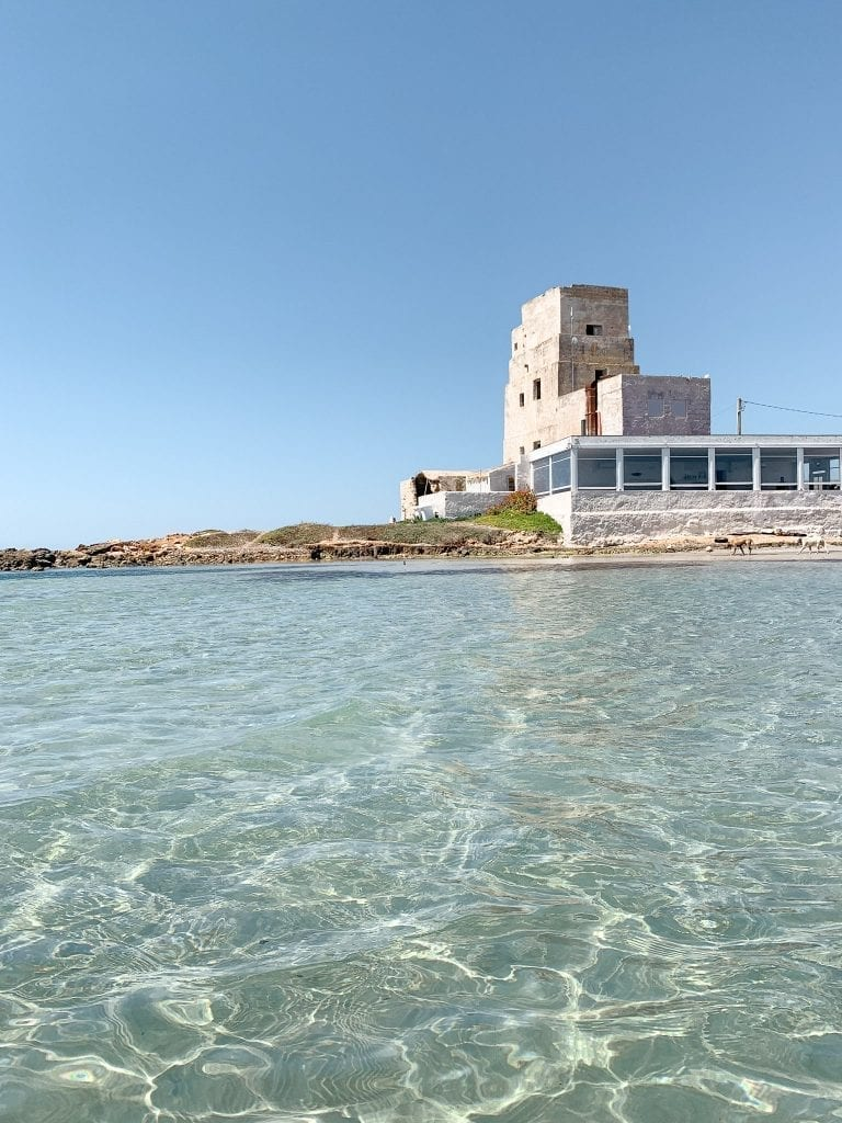 view of the torre di san teodoro from its crystal clear seawater