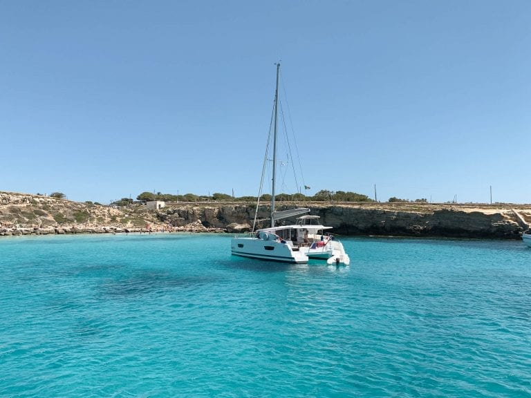 take a sailing boat from Trapani for the island hopping and you cannot miss the endless blue lagoon near Favignana and Levanzo islands