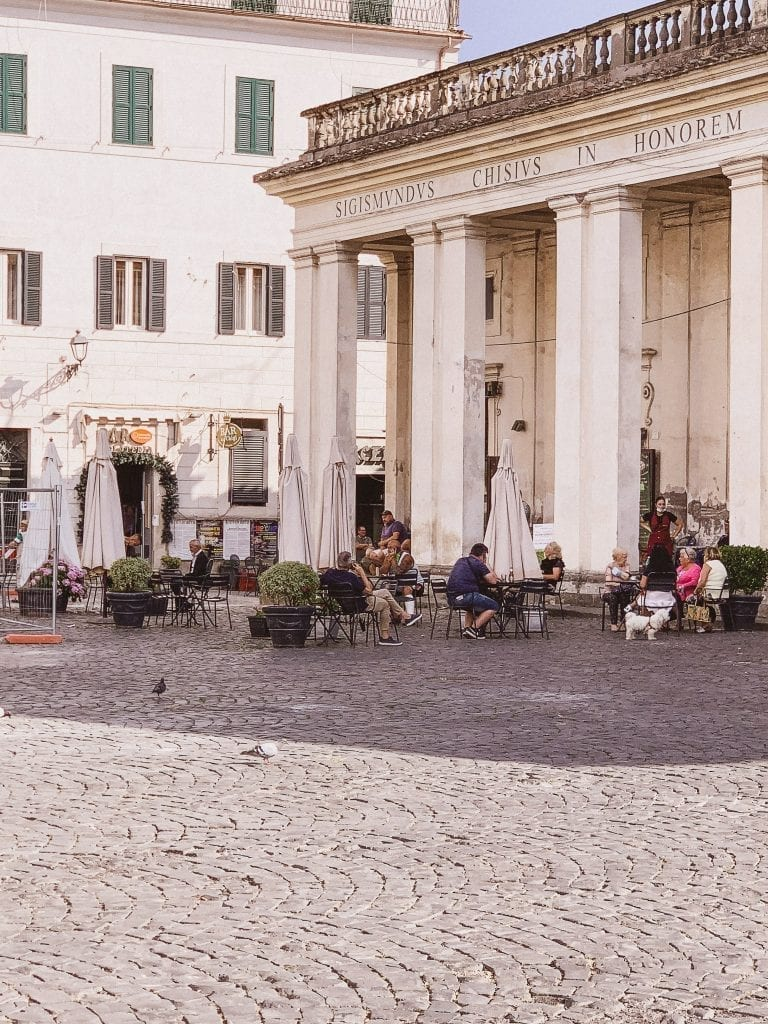 People chilling with coffee espresso and waiting for a fresher night to arrive in Ariccia during the late afternoon hours