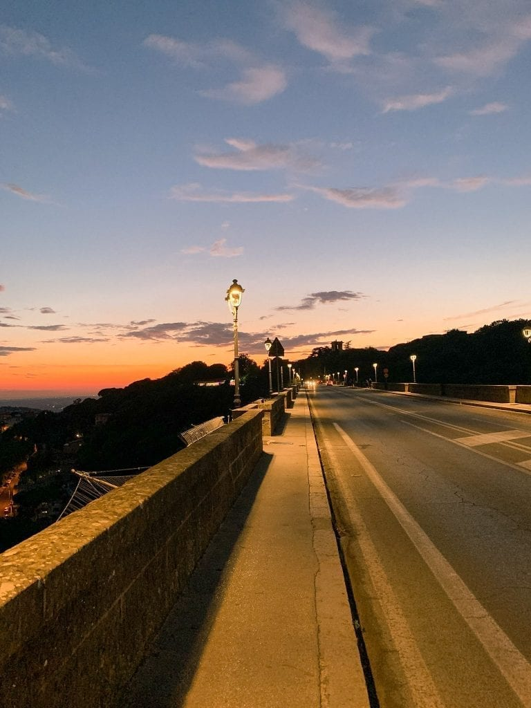 The sky is burning during Ariccia's summer sunset and the long bridge is the best spot to enjoy the view
