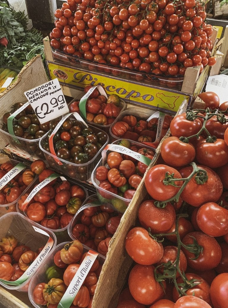 all different kinds of sweet and juicy tomatoes in a fresh market in Rome