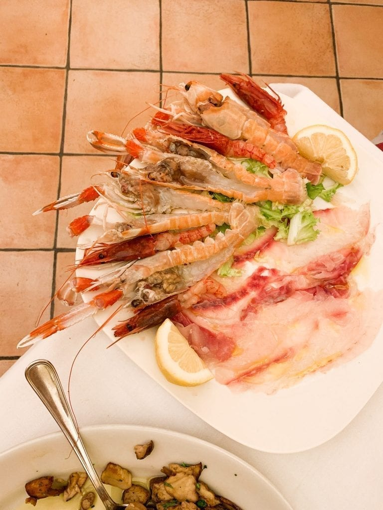 Savor a huge platter of super fresh raw seafood platter by Trattoria da Teo in Trastever is our recent favorite thing to do