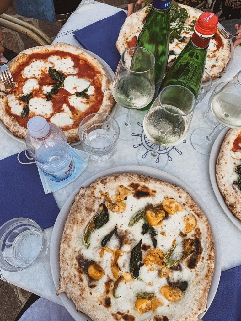 Dinner at Pizzeria da Ciro in Gaeta must be their famous Neapolitan pizza with all fresh southern Italian ingredients like yellow tomato, fish and zucchini flowers.