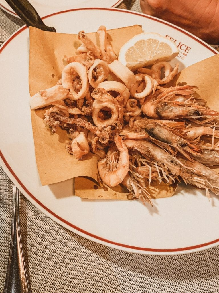 Where to eat in Rome September list, Felice a Testaccio is the most famous restaurant for authentic Roman cuisine and who can say no to a perfect deep fried mixed seafood in the summer