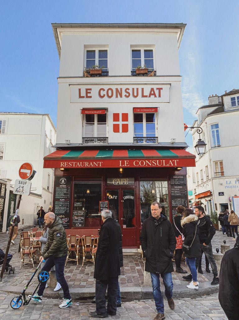 busy and vivid montmartre area in Paris for tourists and locals